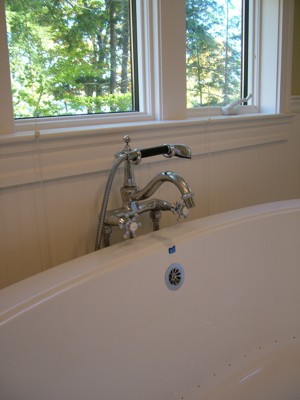 This Roman tub faucet has got plenty of class to compliment this comfortable soaking tub. PHOTO CREDIT:  Tim Carter