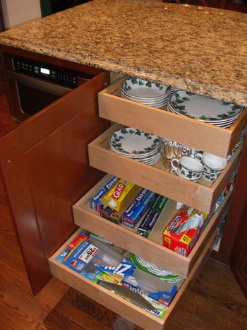 This Kitchen Cabinet Has Four Drawers That Operate On Smooth Rollers All Of Which Are Hidden