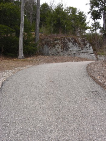 This asphalt driveway is eight years old and has survived punishing frost heaves with little cracking. PHOTO CREDIT:  Tim Carter