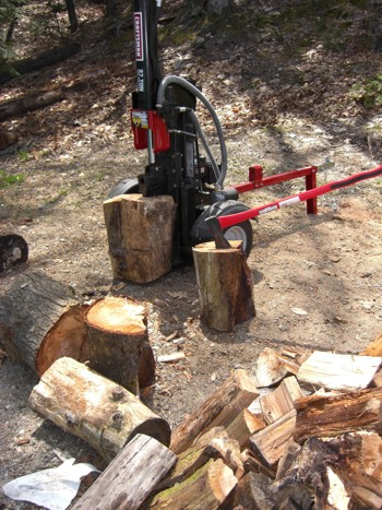 The two extremes of firewood spitting tools are shown here. You can use a human-powered maul, or choose 27 tons of hydraulic pressure! PHOTO CREDIT:  Tim Carter