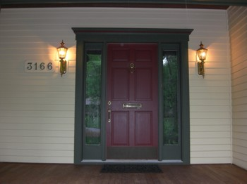 These two outdoor sconces are sized correctly and are at the right height off the porch floor. PHOTO CREDIT:  Tim Carter