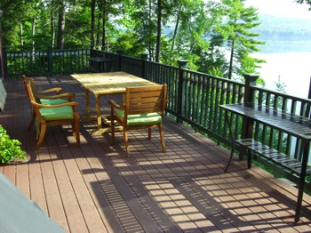 One of your decisions when staining a deck is to choose whether you want a colored or clear finish. PHOTO CREDIT:  Tim Carter