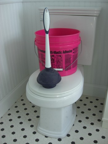 This plunger and a 5-gallon bucket are usually all you need to fix a clogged toilet. PHOTO CREDIT: Tim Carter