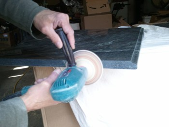 PHOTO CAPTION: A drill outfitted with a flexible pad equipped with special silicone-carbide sandpaper allows you to dry polish marble. PHOTO CREDIT:  Tim Carter