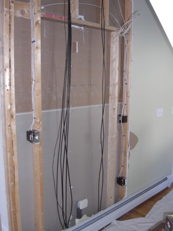 Surprise, surprise! When you go to install a pocket door in an existing home, you're often met with challenges like these cable TV wires. PHOTO CREDIT:  Tim Carter