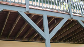 These two diagonal braces help prevent the deck from moving side to side. It would have been better if they had been bolted instead of nailed. PHOTO CREDIT:  Tim Carter