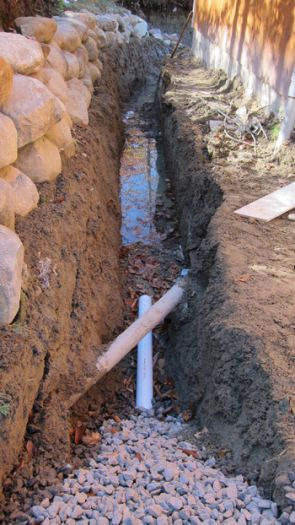 This is a trench nearly 5 feet deep. The coarse gravel allows water flowing through the soil to fall rapidly to the bottom and flow into the drain pipe. PHOTO CREDIT:  Tim Carter