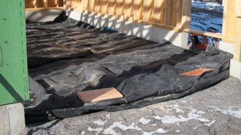 These look like tarps, but they're really special outdoor blankets that help hold heat into the ground. Photo Credit: Tim Carter