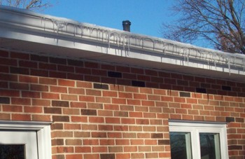 Icicles hanging from gutters that have gutter guards installed. PHOTO CREDIT: Lea Ann Baker