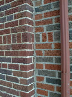 Here is a huge mistake.  They matched texture perfectly but the newer brick on the right has too much orange in it.