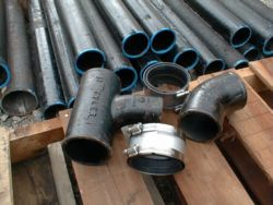 Cast iron pipes and fittings are joined together with rubber seals and stainless steel band clamps. These can be assembled just as easily as gluing PVC pipe.