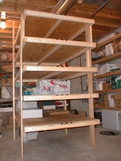 These simple shelves were in my own basement. But they were removed, so I could build a glass block greenhouse for Kathy!