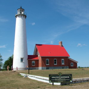 The brilliant white finish on the Tawas Point lighthouse on Lake Huron could be a coating of pure lime. It dries pure white. There is a possibility pure lime was also used inside the house next to the lighhouse. PHOTO BY: Tim Carter